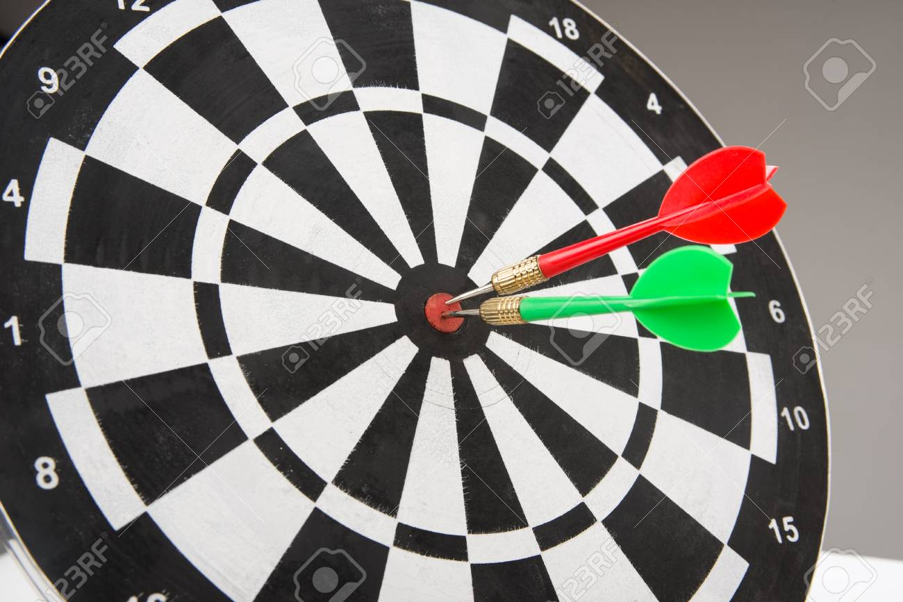 image of dart board with darts